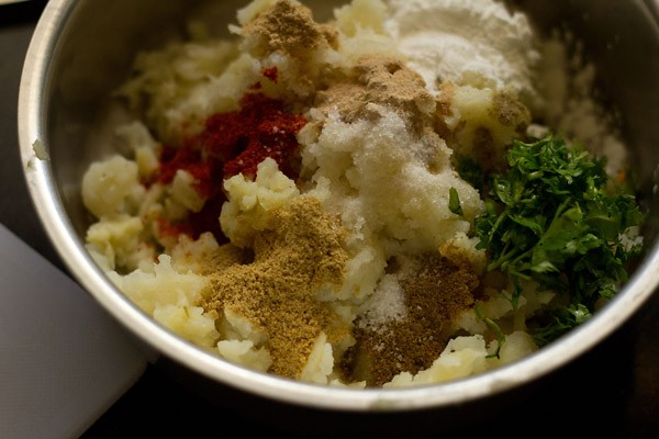 add spices - making aloo tikki recipe