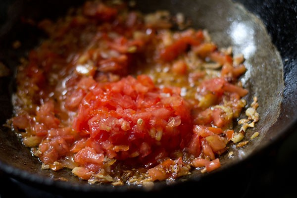 add tomatoes - making mix vegetable recipe