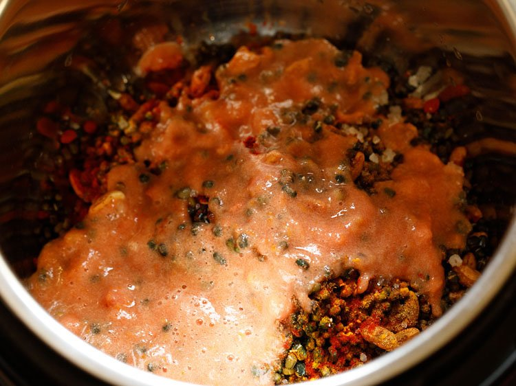 tomato, ginger, garlic puree added on the lentils