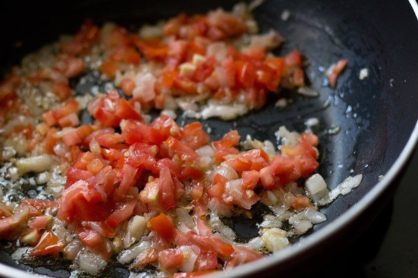 adding finely chopped tomatoes