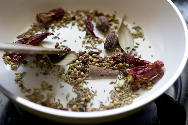 roasting spices for chole masala or chana masala