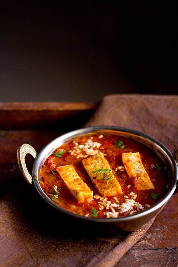 kadai paneer recipe gravy in a small copper kadai garnished with coriander sprigs