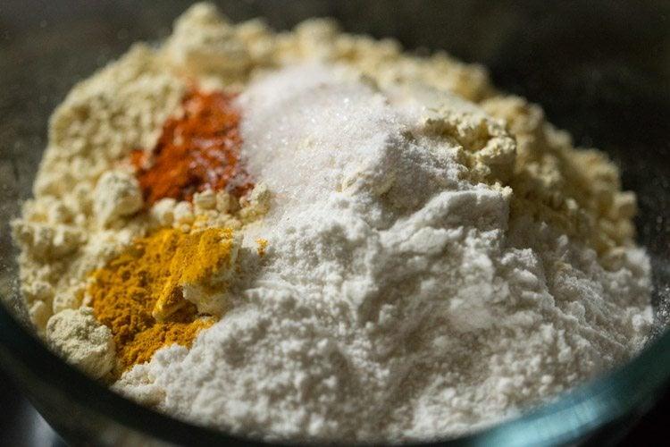 making raw banana pakora or bajji recipe