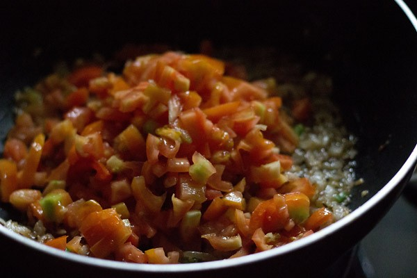 add tomatoes - making pav bhaji recipe