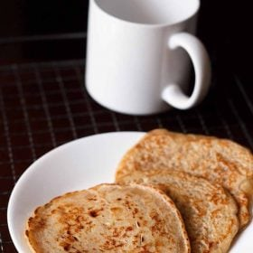 Punjabi puda served on a white plate
