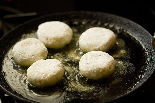 frying farali patties on a tawa