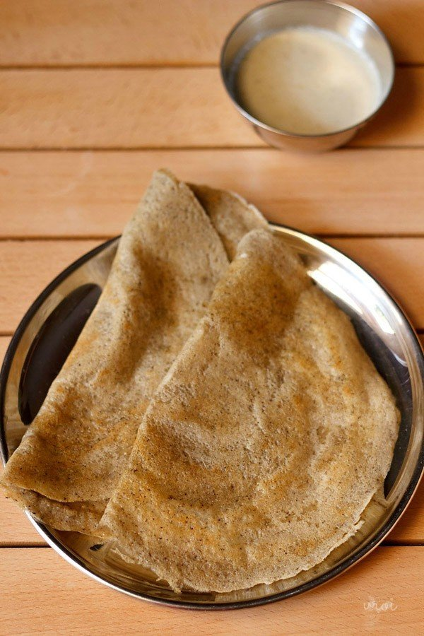 mixed dal dosa served in a plate with a side of coconut chutney