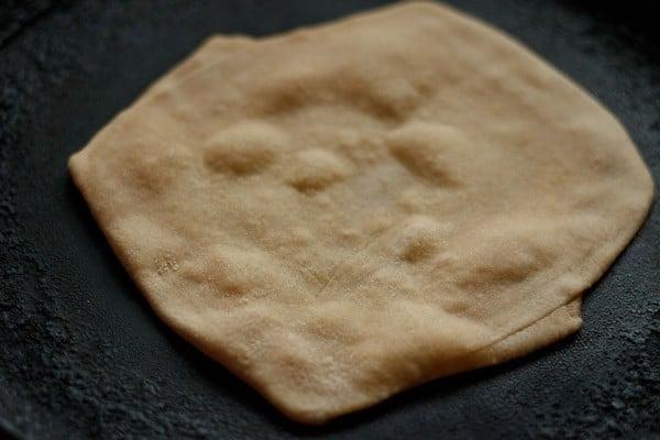 frying plain paratha