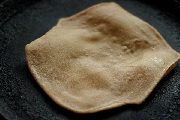 frying plain paratha