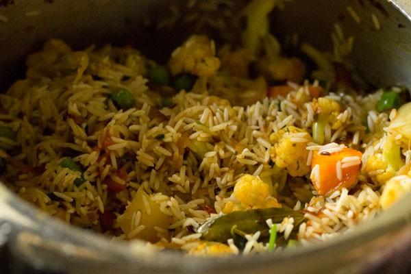 preparing spicy vegetable pulao recipe