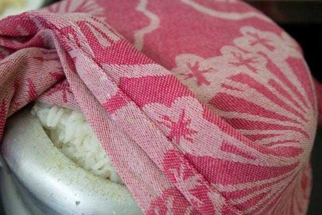 veg biryani covered with wet cloth