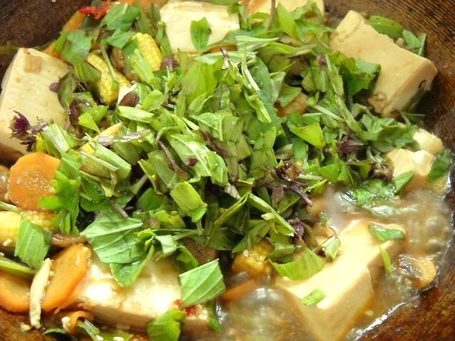 adding chopped basil leaves