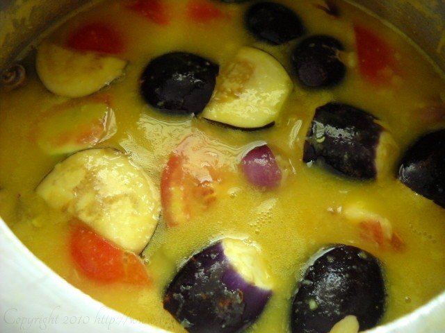 adding vegetables to the cooked dal - kerala sambar