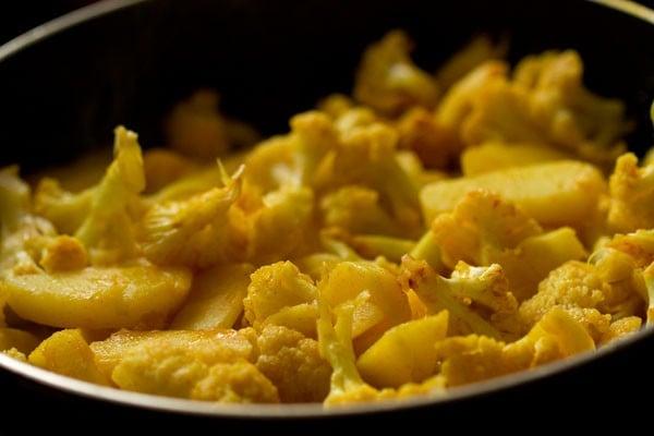 preparing aloo gobi recipe