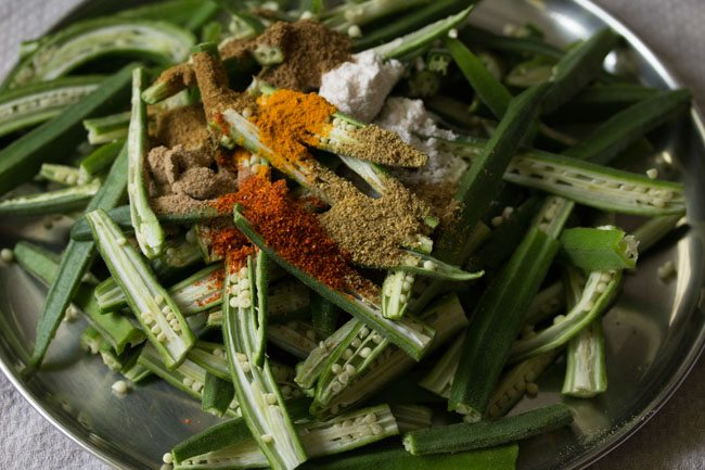 adding spices for kurkuri bhindi