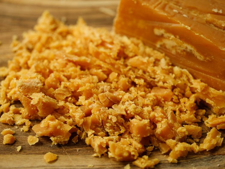 chopped jaggery on a wooden board