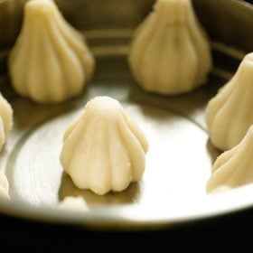 modak pans placed in the pot for steaming