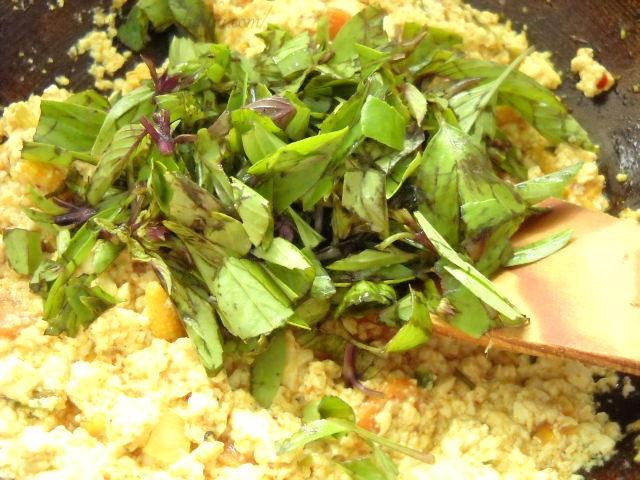 adding-Thai-basil-leaves