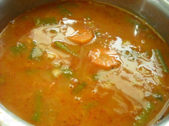 adding boiled vegetables for veg thai curry