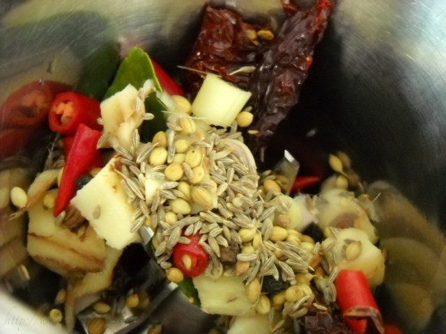 adding spices in grinder for thai red curry