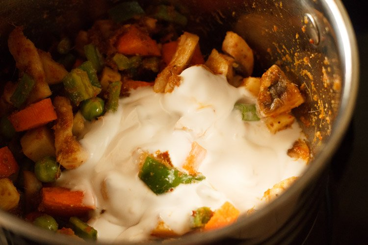 adding coconut milk for Thai red curry