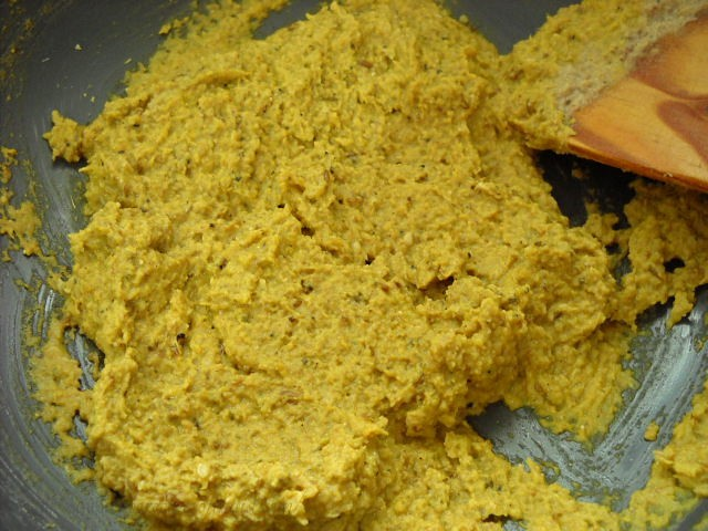 mixing turmeric powder with baingan masala