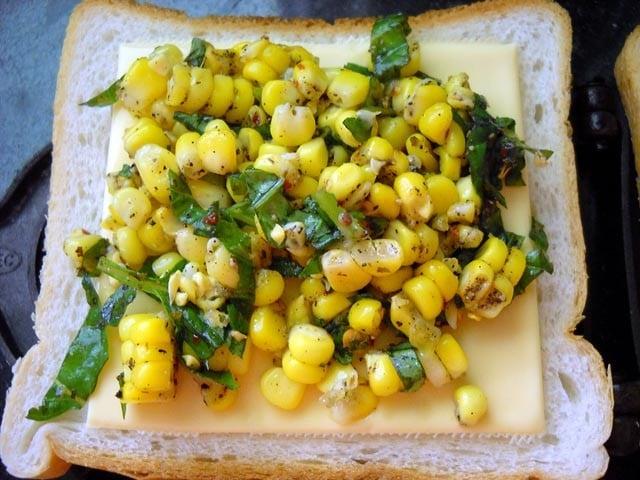 corn mixture on cheese slice