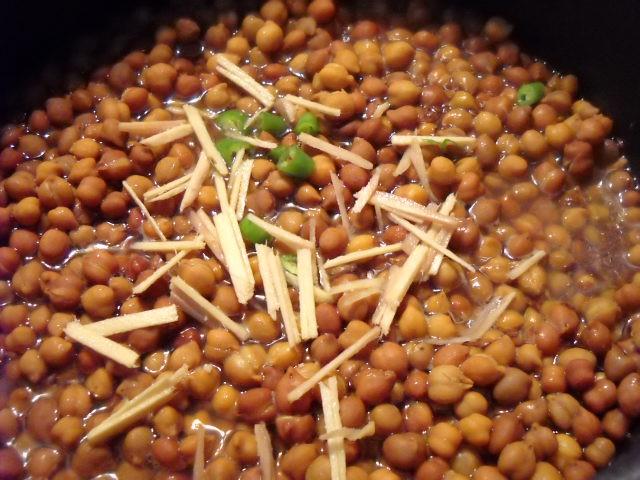 adding ginger chili for kala chana recipe