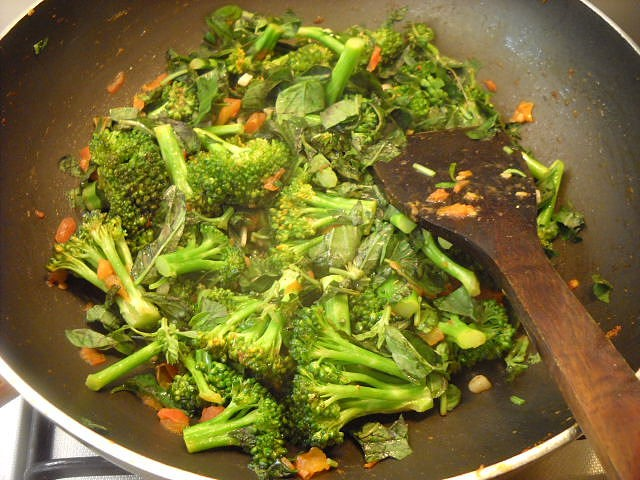 mixing broccoli with basil