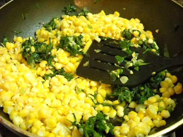 adding corn to make palak corn recipe