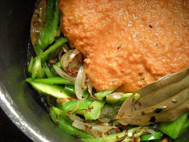 adding tomato masala paste