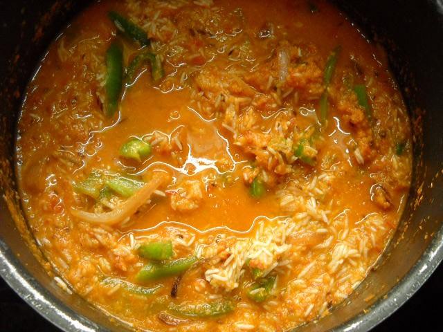 adding water to tomato rice recipe