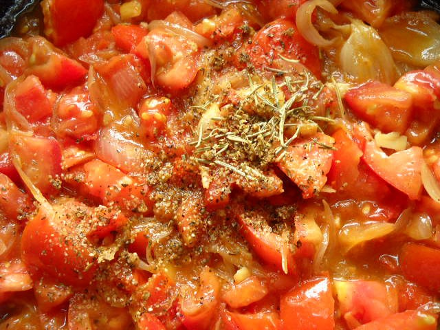 adding herbs for tomato mushroom penne pasta recipe