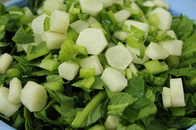 adding chopped radish for palak saag