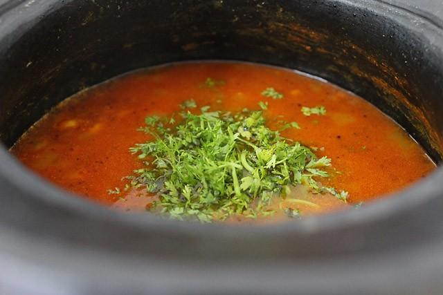 garnished rasam with coriander