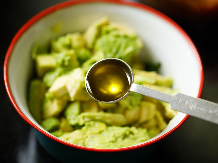 extra virgin olive oil being added