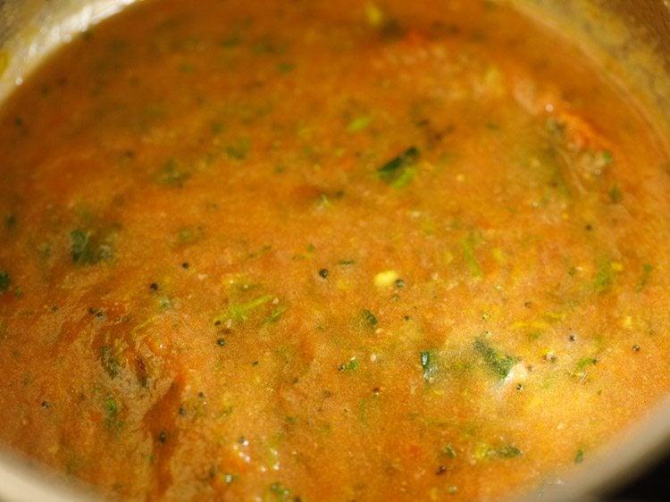 making tomato rasam recipe