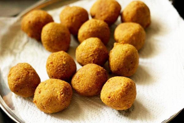many fried falafel balls placed on kitchen paper towel