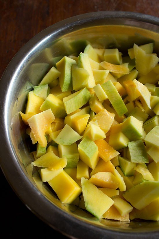 wash the mangoes for sweet sour mango pickle