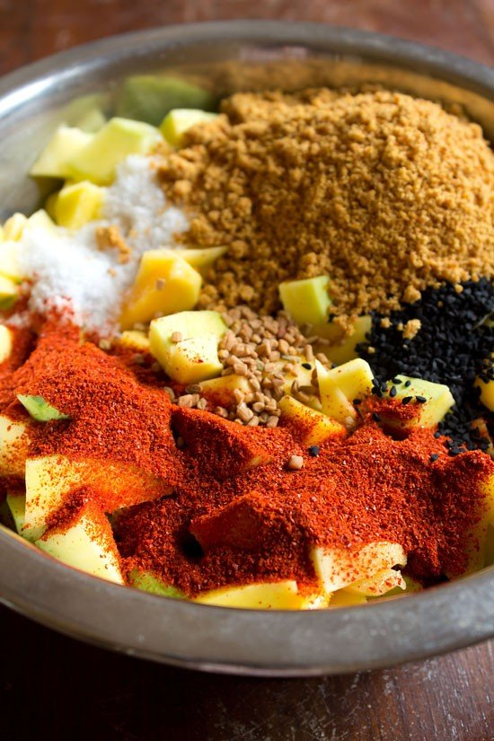 add spices to mangoes for pickle recipe
