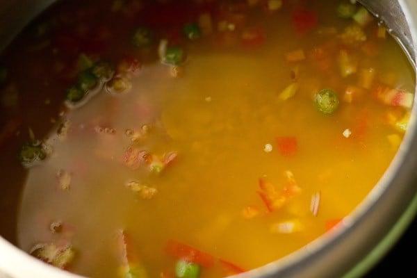 preparing dal tadka recipe restaurant style