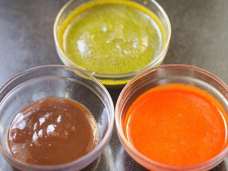 chutneys kept in three glass bowls for making bhel puri recipe