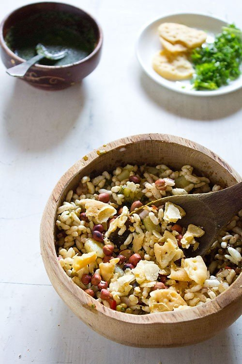 adding papdis to bhel puri recipe