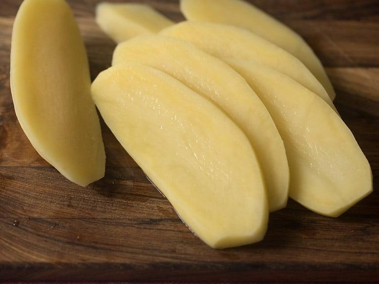 peeled potato sliced thinly