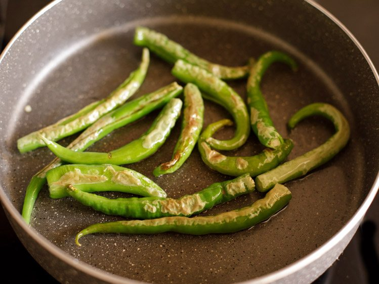 Fry the chilies till light brown