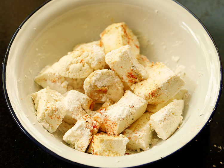 In a bowl take paneer cubes, tapioca starch and spices for marination