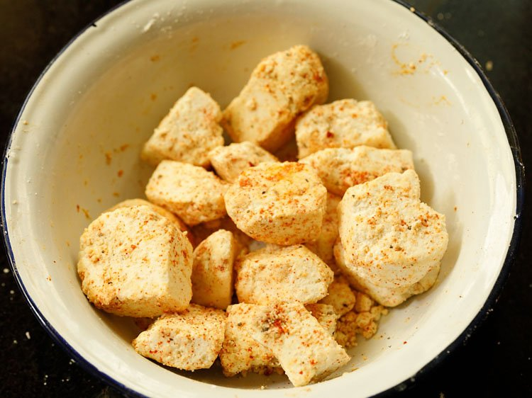 mix so that cornflour and seasonings coats the paneer cubes