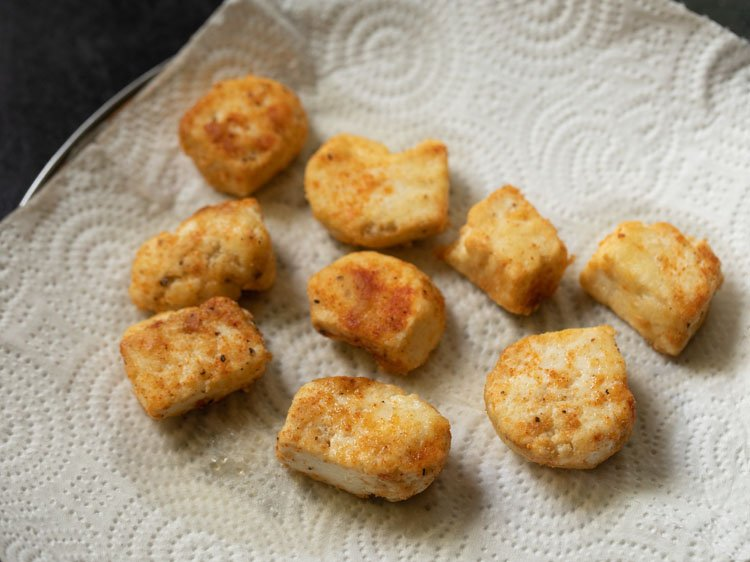 fried paneer cubes on kitchen paper towels