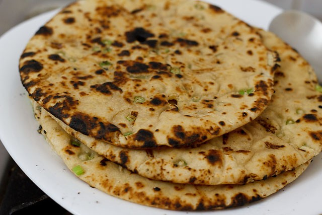 cooking garlic naan on fire