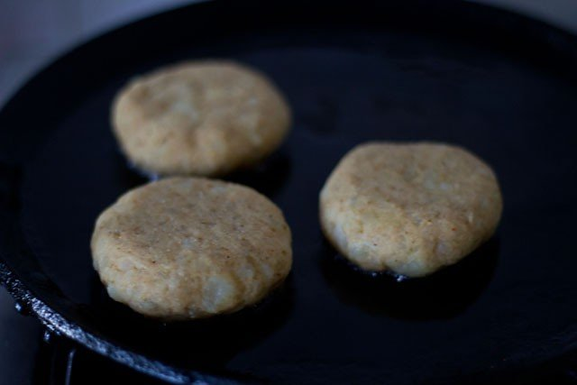 frying tikkis for making aloo tikki chole recipe
